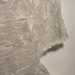 Straubing_The Garment Presser Takes Her Tightly Bound Broomstick Bundle To Press Detail 1